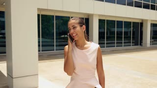 Happy Business Woman Talking On Mobile Phone Walking
