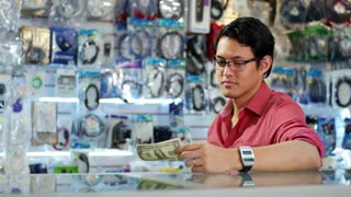 Happy Chinese Computer Shop Owner Showing First Dollar