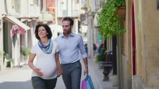 Happy Husband And Pregnant Wife Shopping
