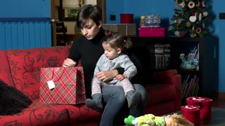 Happy Woman And Baby Girl Opening Present Gift For Christmas