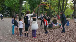 Happy young Japanese people, Asian kids, friends, leisure activity, group of children having fun, playing in city park, family recreation. Tokyo, Japan, Asia