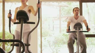 Happy young people, fun, leisure, lifestyle, fitness club, sports and workout, man and woman training in gym for wellness and well-being
