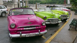 Havana, Cuba. Restored vintage American cars from the 50s in the street, old 1950s cars rented as Cuban taxi for tourists. Transportation, automobile transport, traffic, city tourism, travel