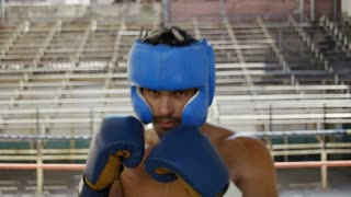 Hispanic man training in boxing gym athlete boxe combat sport