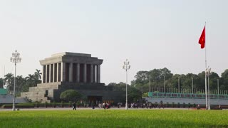 Ho Chi Minh mausoleum in Hanoi, Vietnam, Asia, and Vietnamese flag in the sky. Sequence with original sound
