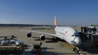 Incheon International Airport, Seoul, South Korea, Asia. Passenger terminal with Airbus A380 airplane, plane, jet, aircraft under maintenance check. Air transportation travel. Time-lapse