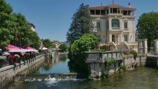 Isle Sur La Sorgue, small town in Provence, France with river. Summer holidays, landscape, French nature, tourists