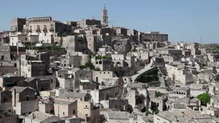 Italy, Italia, Basilicata, Lucania travel, people and city. View of Matera, with old homes called Sassi, Unesco World Heritage Site. Sequence