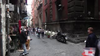 Italy, Italia, Naples, Napoli travel, people and city. View of street and square in Spaccanapoli district. Sequence