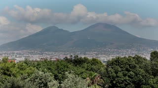 Italy, Italia, Naples, Napoli travel, people and city. View of Vesuvius volcano, Mount Vesuvius, Vesuvio and street with traffic and theme park. Sequence