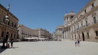 Italy, Italia, Sicily, Sicilia travel, people and city. View of Syracuse, Siracusa, Duomo square, cathedral, baroque art, and Ortygia island, Mediterranean sea. Sequence