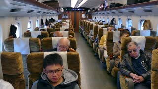 Japanese people traveling on Shinkansen bullet train in Japan, Asia. Modern railway transportation, fast travel, travelers and Asian commuters