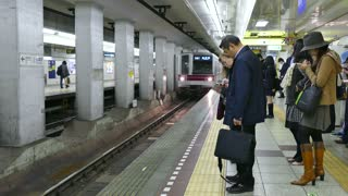 Japanese people on platform, traveling on train, Tokyo, Japan, Asia. Rush hour, subway underground station, fast transportation and Asian commuters