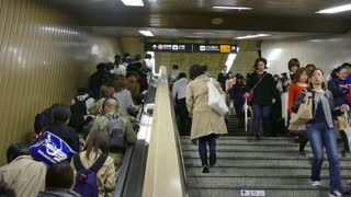 Japanese people walking on stairs and escalator, traveling on train, Tokyo, Japan, Asia. Rush hour, subway underground station, transportation and Asian commuters