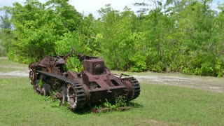 Japanese tank, military vehicle in jungle. Battle of Peleliu, Palau (Operation Stalemate II) fought between the United States and the Empire of Japan in the Pacific Theater of World War II in 1944