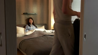 Japanese Wife In Bedroom And Husband Getting Ready For Work