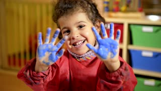 Kids, school and education, happy children having fun and painting with hands in kindergarten