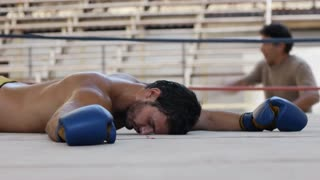 Knock out KO for latino man fighting in boxing ring