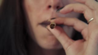 Latina Woman With Lighter Smoking Hashish Joint Marijuana Cigarette