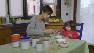 Lifestyle Baby And Woman Cooking Together In Home Kitchen
