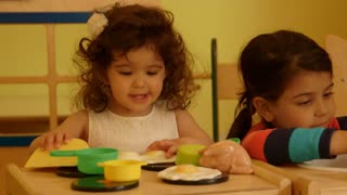Little children and educator playing in kindergarten.mov