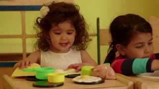 Little children, baby, playing in kindergarten, school. Little girls, sisters, happy female friends playing with toys in preschool. Recreation and education