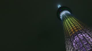 Low angle view of Skytree tower, Tokyo, Japan, Asia. Modern building, monument, landmark, neon lights. Asian and Japanese urban landscape, metropolitan design architecture. Copy space, night sky