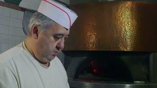 Man At Work Chef Making Pizza In Italian Restaurant Kitchen