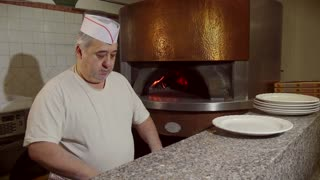 Man Cook Making Pizza In Italian Restaurant Kitchen Food Preparation