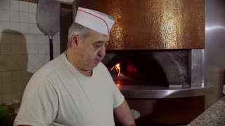 Man Working Cook Making Pizza In Italian Restaurant Kitchen Italy