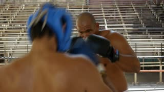 Men fighting in boxing ring athletes boxe people extreme sport