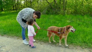 Mom And Daughter Smiling With Dog Pet Leisure In Park