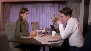 Morning Lifestyle With Happy Businessman And Woman Having Breakfast Talking