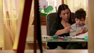 Multitasking mom working at home with children, busy with daughter and son, talking on telephone. Woman, family stress, parenting, motherhood. Businesswoman, manager at work in office, telework