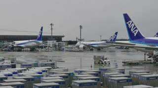 Narita International Airport, Tokyo, Japan, Asia. Passenger terminal with airplanes, planes, jets, aircrafts under maintenance check, fuel service. Air transport, airline workers, people working