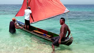 Native Panama Fishermen With Sailing Boat In Caribbean Sea