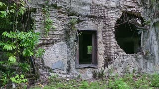 Old bombed military building in jungle. Battle of Peleliu (Operation Stalemate II) fought between the United States and the Empire of Japan in the Pacific Theater of World War II in 1944