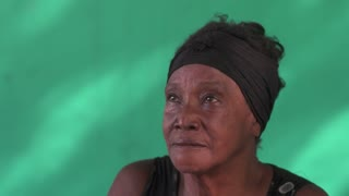 Old Cuban people and emotions, portrait of sad senior african american lady looking at camera. Depressed elderly black woman from Havana, Cuba. Anxiety, sadness, depression