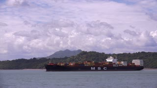 Panama City Canal With Cargo Container Ship Sailing 4K