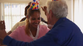 Patient Dancing With Nurse During Party In Hospice
