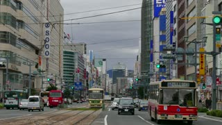 Peace Boulevard (Heiwa O-dori) in Hiroshima, Japan, Asia. View of a Japanese city with modern buildings, traffic, cars, people walking in the street