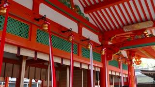People and pilgrims praying at Fushimi Inari Shrine or Fushimi Inari Taisha, a Shinto shrine in southern Kyoto, Japan, Asia. Japanese monument, Asian landmark, religious building