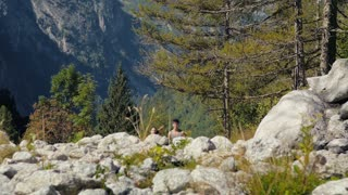 People and sport activity, young man and woman running on mountain trail. Slow motion