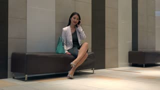 People and technology in hotel lobby, office building. Japanese female manager. Asian businesswoman, elegant girl, woman at work, talking with mobile phone, telephone during break