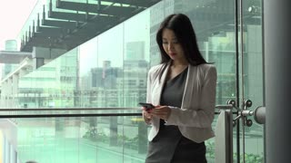 People and technology in office building. Japanese female manager. Asian businesswoman, elegant girl, woman at work, talking with mobile phone, telephone during break