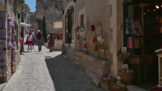 People and tourists shopping in the old village of Les Baux de Provence, Southern France. Beautiful typical French town. Travel, holidays in Europe