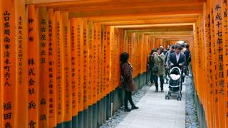 People and tourists visiting Fushimi Inari Shrine or Fushimi Inari Taisha, a Shinto shrine in southern Kyoto, Japan, Asia. Japanese monument, Asian landmark