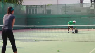 People, man and woman playing tennis, game, match, sport. Tennis school