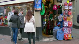 People shopping for gifts in store, tourists buying souvenirs in shop. Amsterdam, Holland, The Netherlands