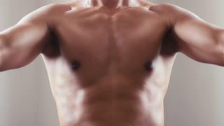 People training, working out, exercising in gym and fitness club, sport and body-building for wellness and wellbeing. Man, athlete practicing as bodybuilder. Close-up of chest and torso